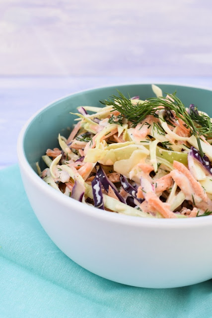 bowl of coleslaw with fresh herbs