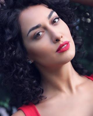 Sadaf Taherian shows her red lips