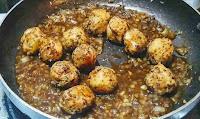 Stir frying manchurian balls with sauces for veg manchurian dry
