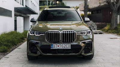 Wallpaper with green BMW luxury car