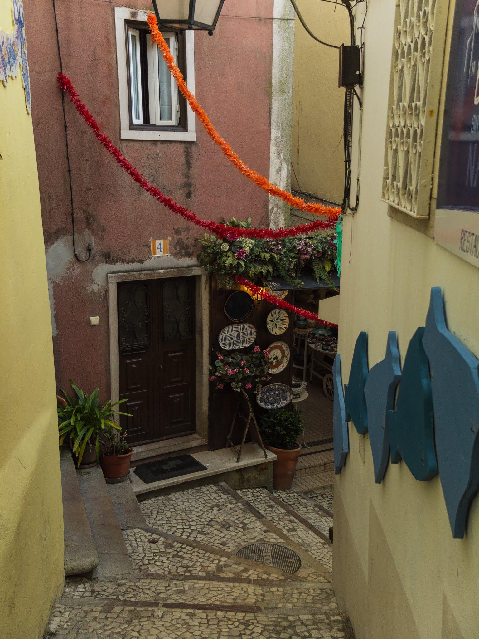 Walking down steps in a narrow street in Sintra, Portugal.