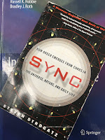 Sync, By Steven Strogatz, superimposed on Intermediate Physics for Medicine and Biology.