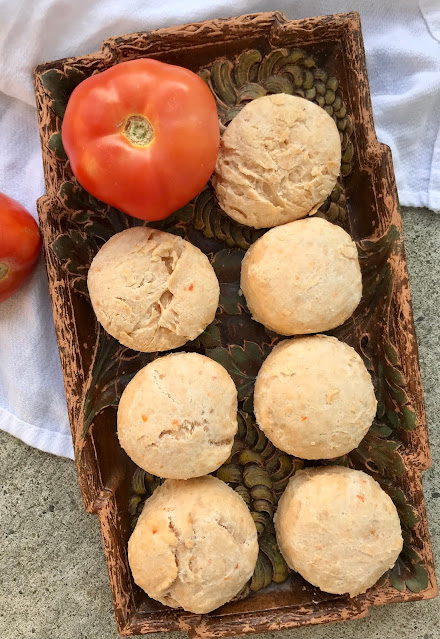 Plate of baked tomato Parmesan buttermilk biscuits.
