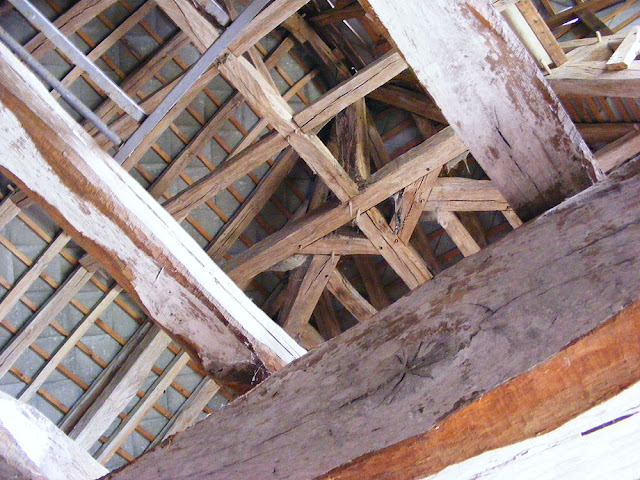 Rafters of a 14-16C house in the countryside.  Indre et Loire, France. Photographed by Susan Walter. Tour the Loire Valley with a classic car and a private guide.