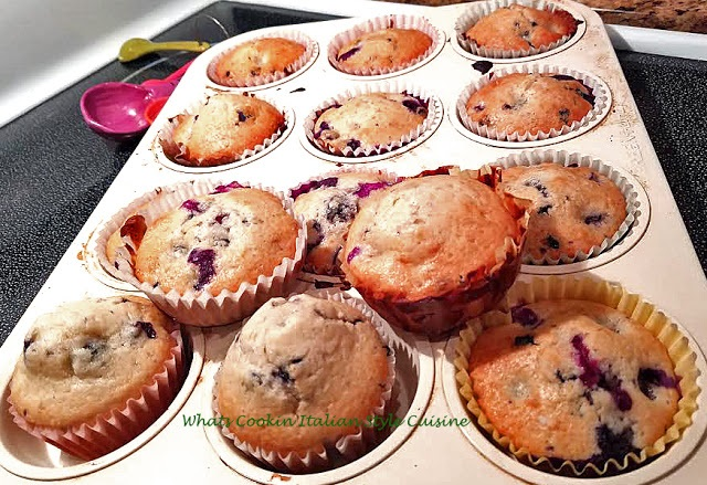 this is a pan of sour cream blueberry muffins