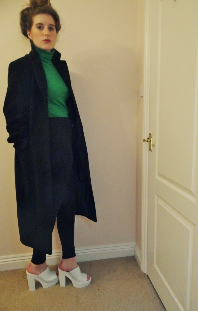 duster coat and polo neck