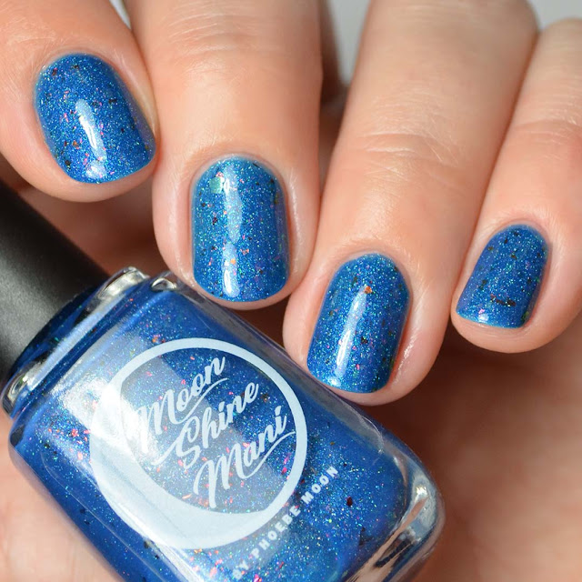 cerulean blue nail polish with color shifting flakies