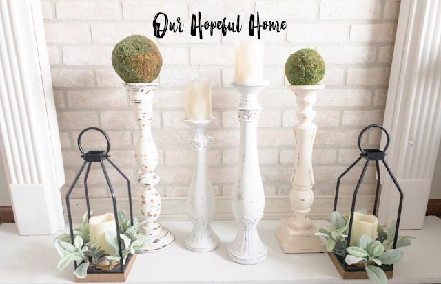 white mantel brick fireplace candle holders lanterns
