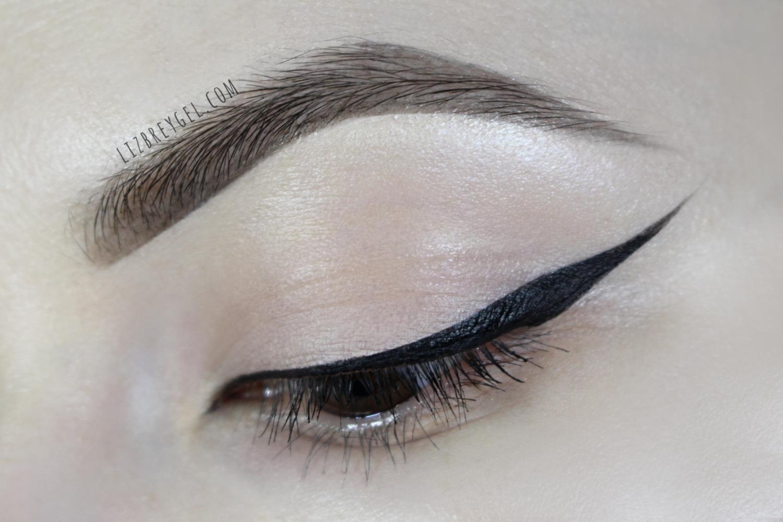 black and sharp cat eyeliner makeup close up