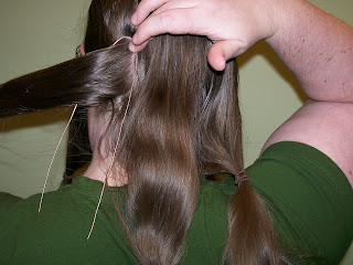 Positioning the wires over the back hair.