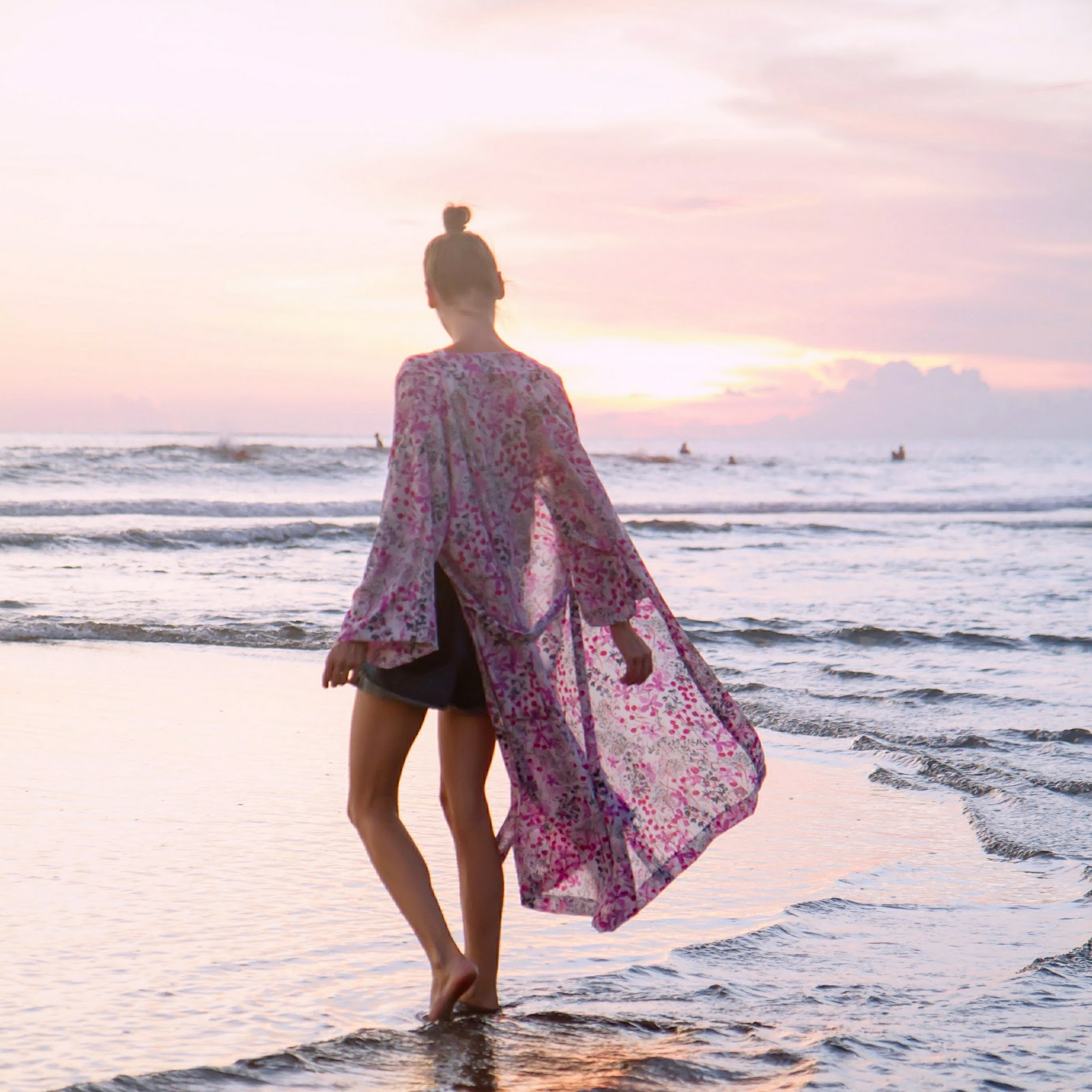 Fashion and travel blogger, Alison Hutchinson, wearing a Kayvalya Kimono in Bali at sunset