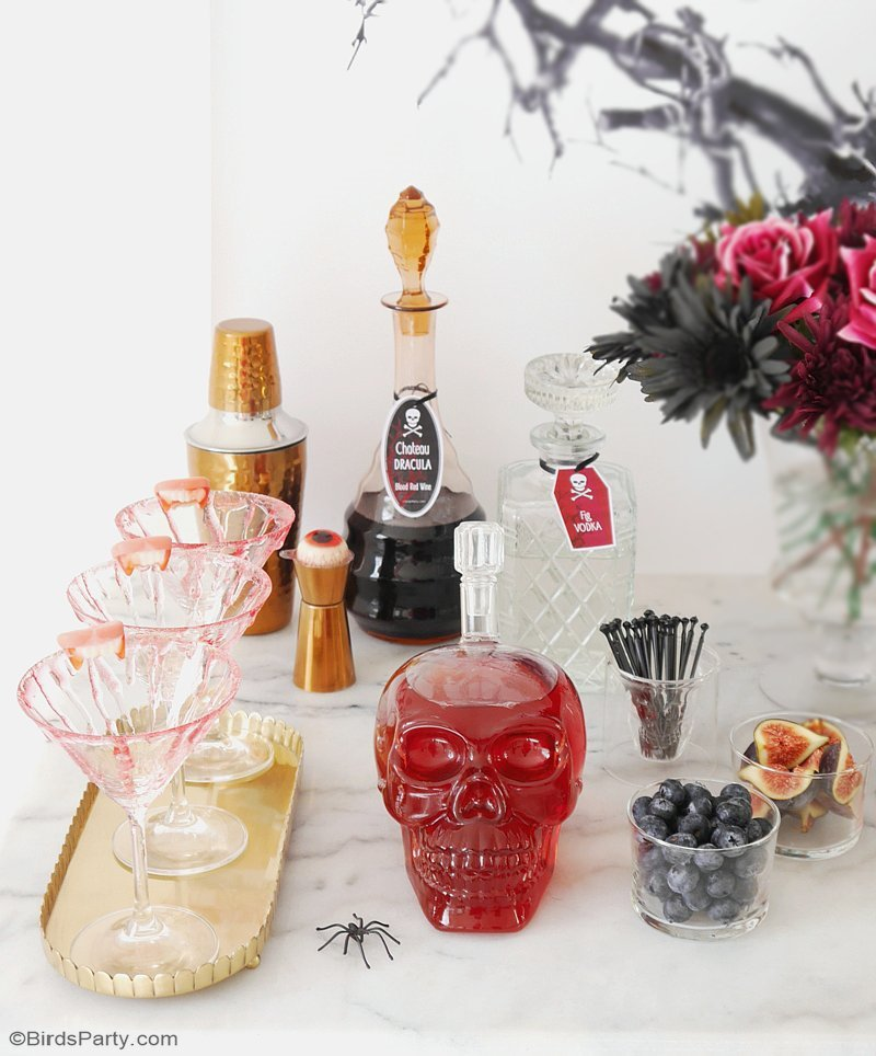 DIY Bloody Halloween Cocktail Glasses  - learn to create this edible blood effect to decorate your cocktail glasses and make them all creepy and spooky! by BirdsParty.com @birdsparty