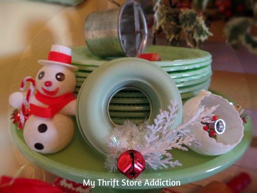 A Holly Jolly Jadeite Kitchen mythriftstoreaddiction.blogspot.com Vintage jadeite collection,a jello mold mini wreath and vintage snowman ornament create a whimsical display
