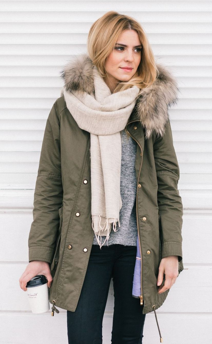 what to wear with a parka : scarf + black jeans + grey sweater