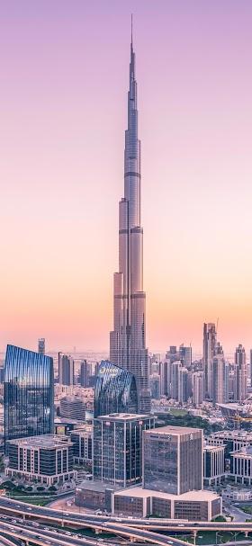 خلفية برج خلفية في دبي لحظة الغروب الهادئ