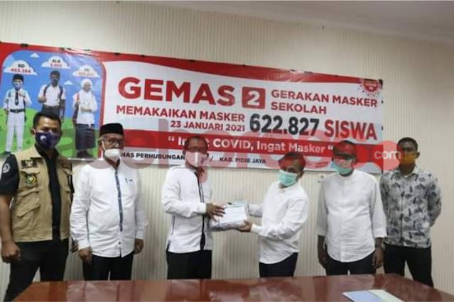 Pemerintah Aceh serahkan Ribuan Masker untuk Sekolah Pidie Jaya