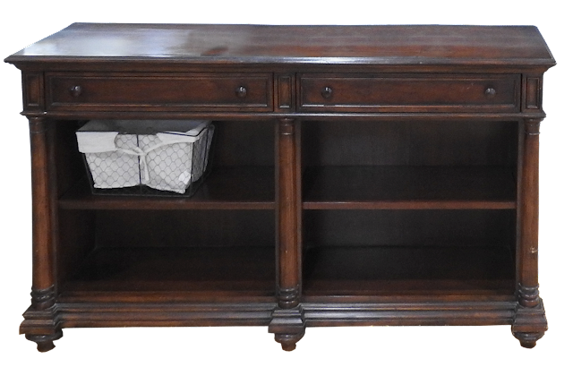 A heavy hall table with shelves and drawers and small decorative front half-columns.