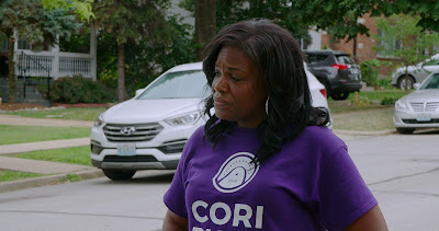 Movie still for Netflix's latest political documentary film Knock Down the House where Cori Bush goes door to door to meet her constituents