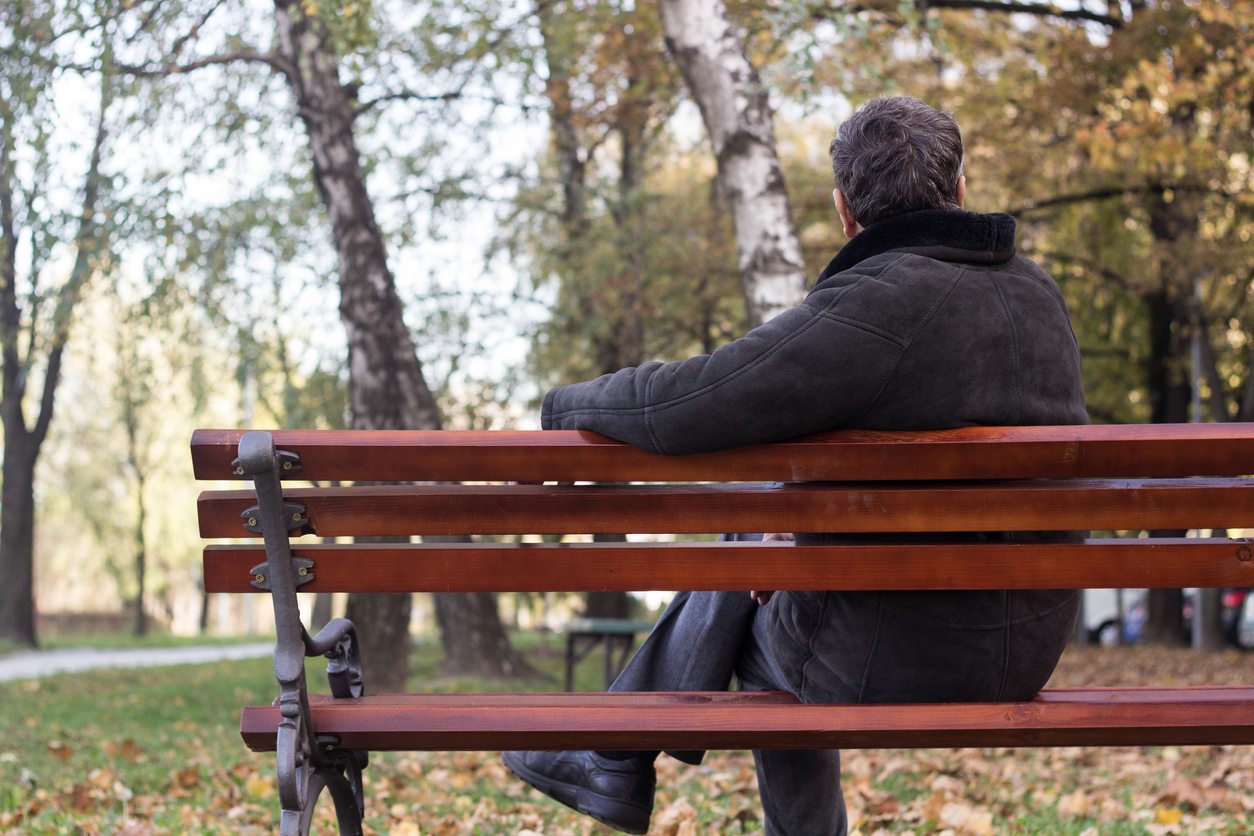 man sitting in a bench