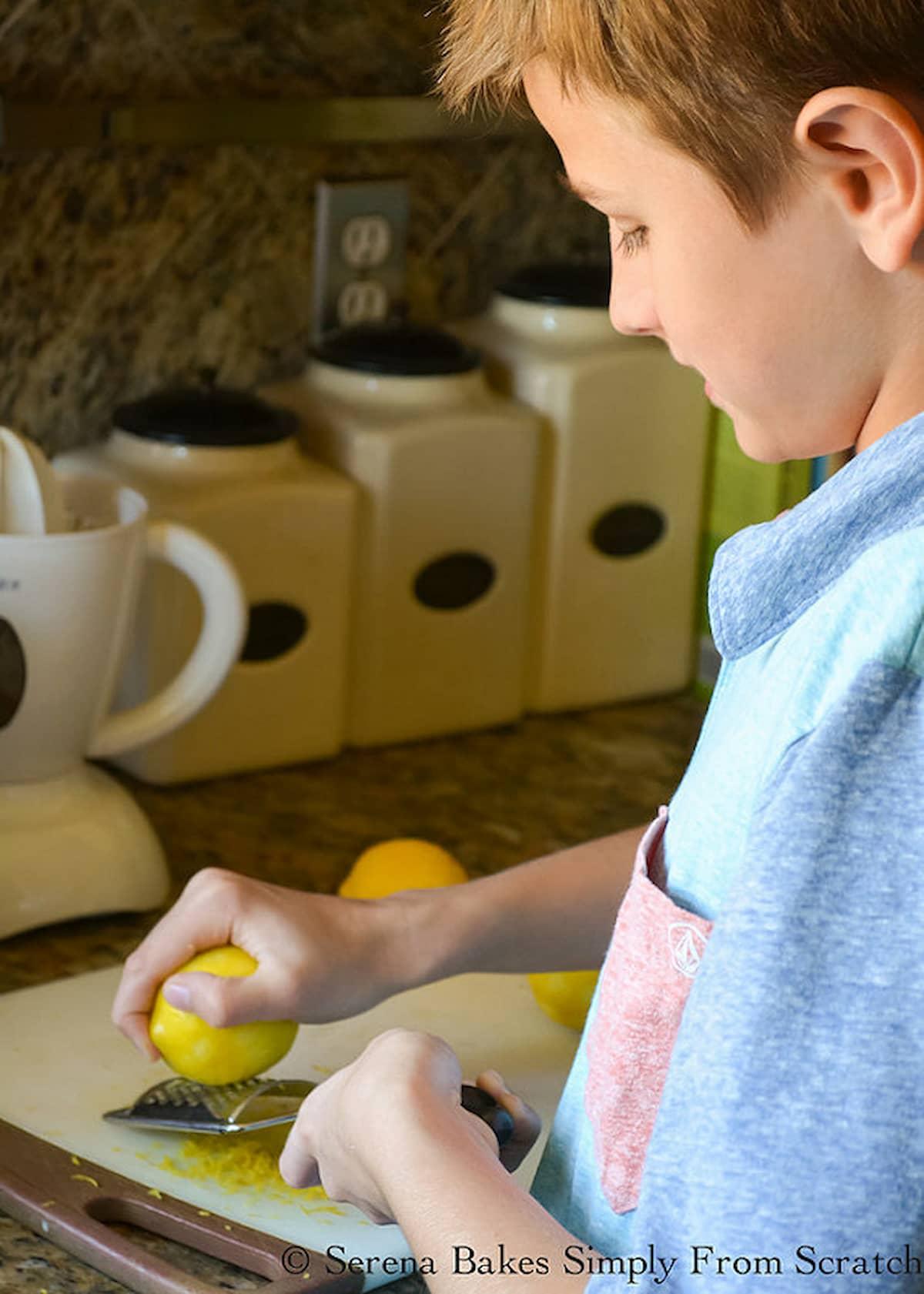 LJ zesting a Lemon on a cutting board.