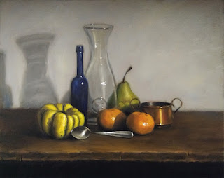 Still life oil painting of a small yellow pumpkin, two mandarines, a spoon, a small copper pot, a pear, a blue castor oil bottle and a carafe.