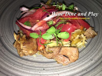 The artichoke salad is served on top of the polov osh dish blending both wonderful flavors together in one