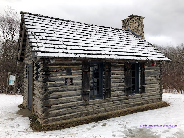 Log cabin playhouse designed by Jens Jensen at Heller Nature Center.