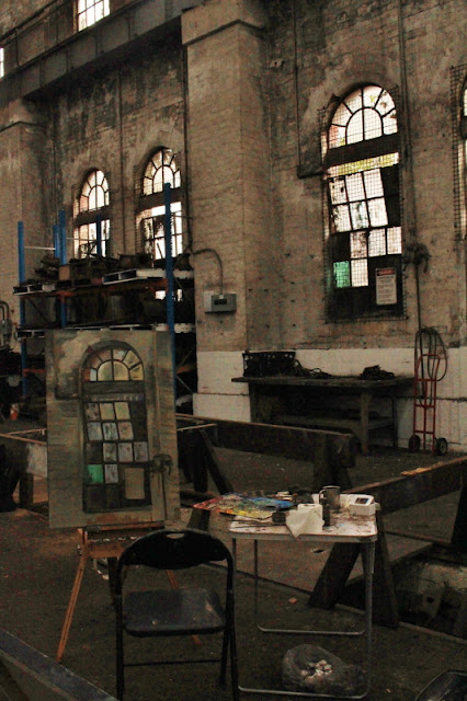 plein air oil painting of windows in the Large Erecting Shop in the Eveleigh Railway Workshops by industrial heritage artist Jane Bennett