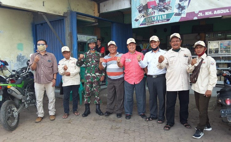 Peduli Covid-19, DPD IKM Kota Serang Bagikan Ribuan Masker Kepada Masyarakat