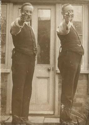 2 men with pistols