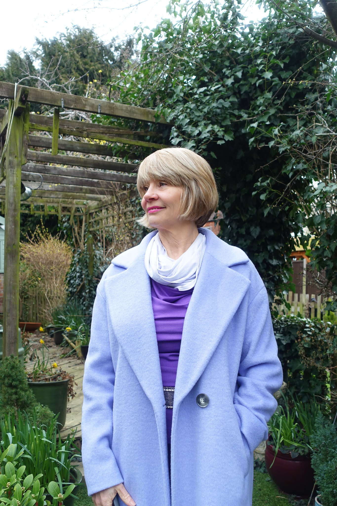 A lavender cashmere coat and shades of purple with silver worn by over 60s style blogger Gail Hanlon from Is This Mutton