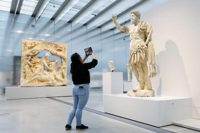 A woman led a virtual tour of the Louvre Lens museum