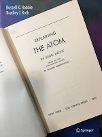 Explaining the Atom, by Selig Hecht, superimposed on Intermediate Physics for Medicine and Biology.