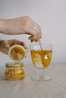 adding turmeric in a glass of water