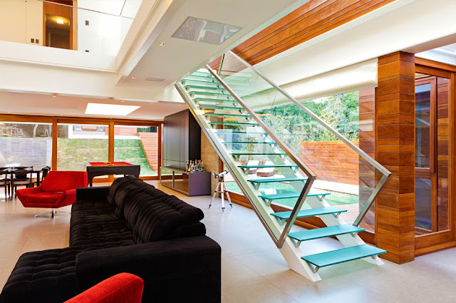 Picture of glass staircase leading from the living room to the upper floor
