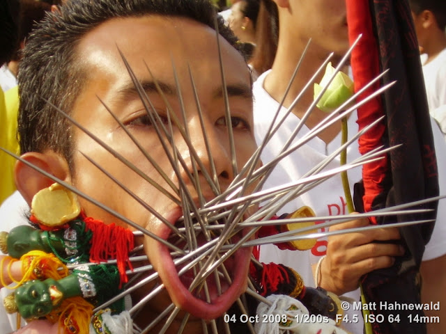 Thailand, Phuket, Vegetarian Festival, Tesagan Jia Chai, Nine Emperor Gods Festival, Taoist celebration, Thai Chinese man, mah song, street portrait, self-mutilation, piercing, impaling, ritualised mutilation