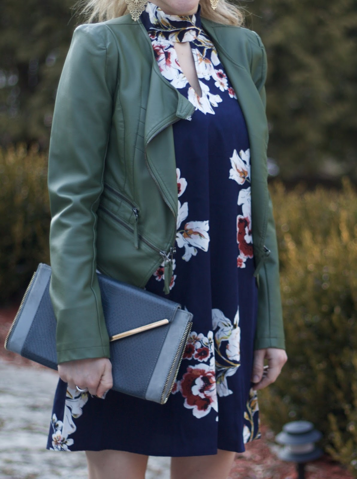 blue floral choker neck dress, olive moto jacket, burgundy heels, grey envelope clutch, spring date night outfit with dress,