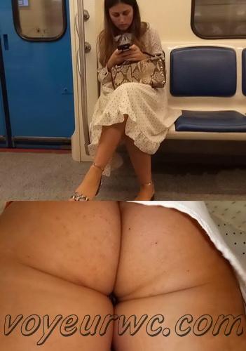 Upskirts 4606-4613 (Secretly taking an upskirt video of beautiful women on escalator)