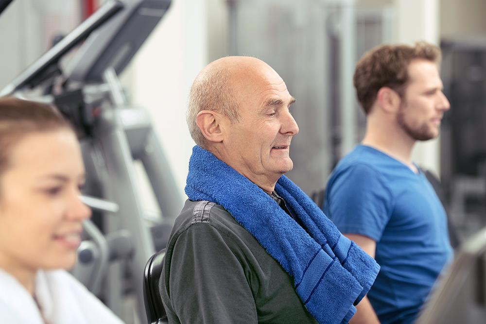 Older man exercising at a gym