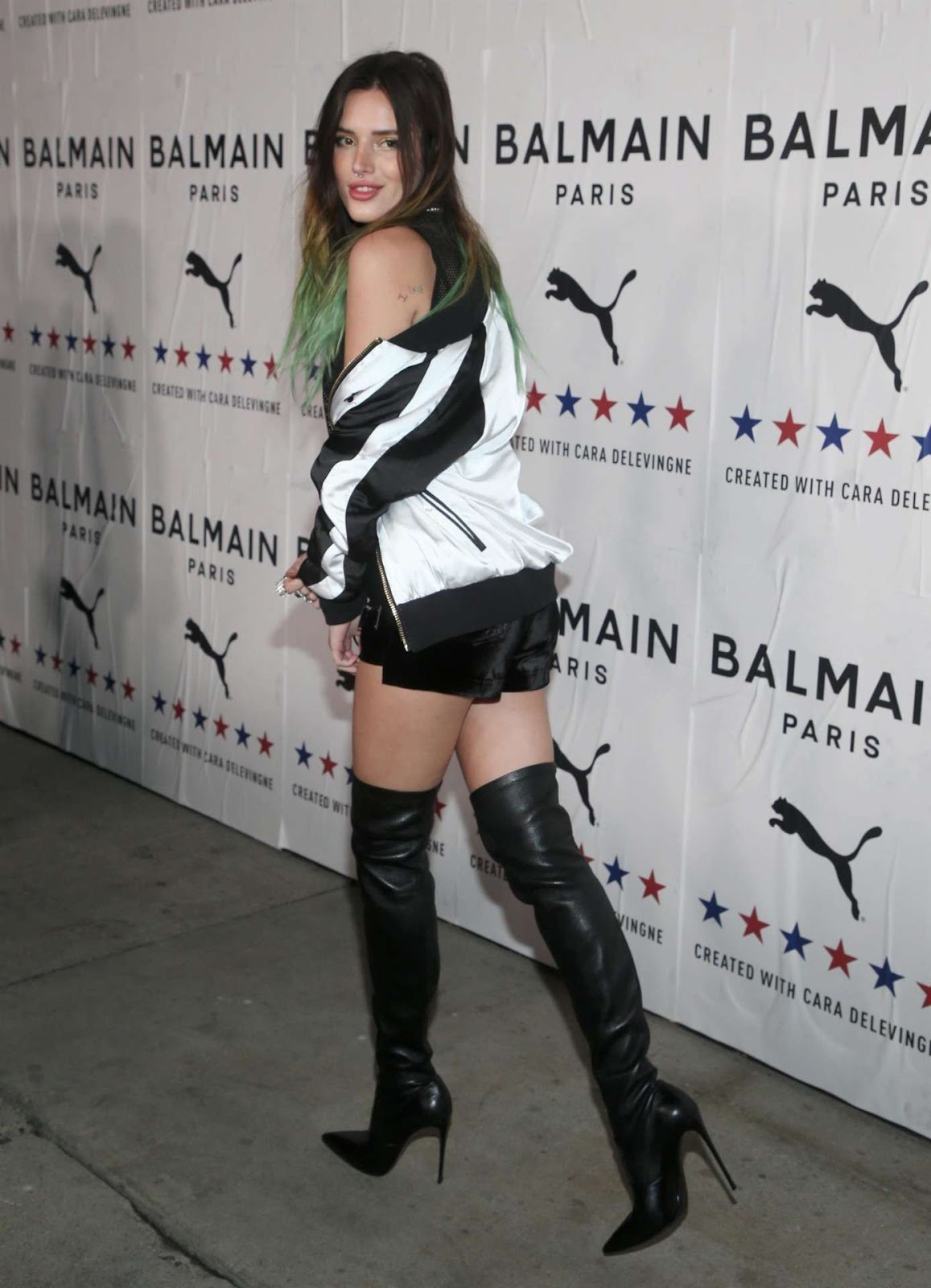 Bella Thorne Leggy in Boots at PUMA x Balmain Launch Event in Los Angeles