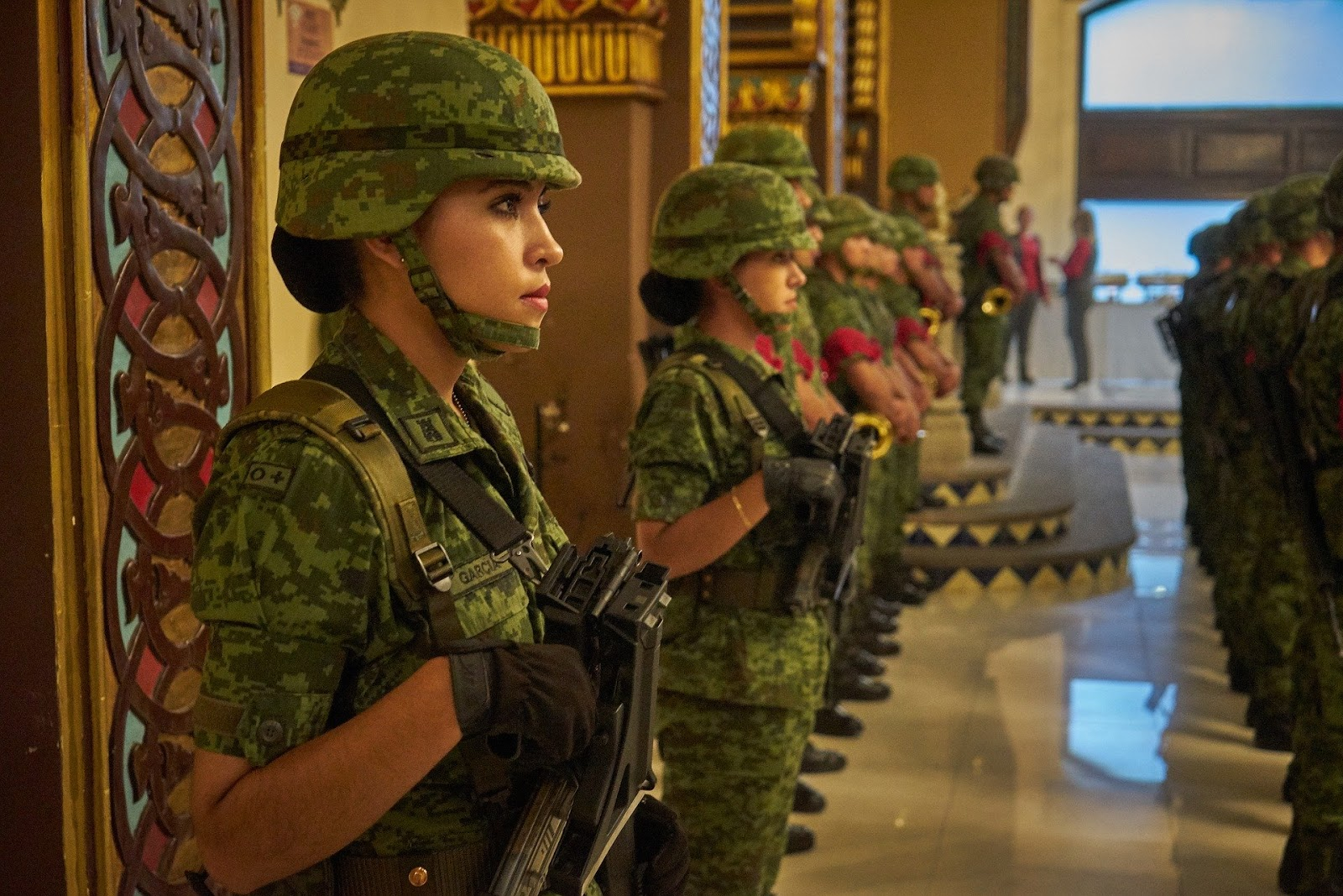a row of women soldiers at attention with their rifles for blog post about movies and women in combat