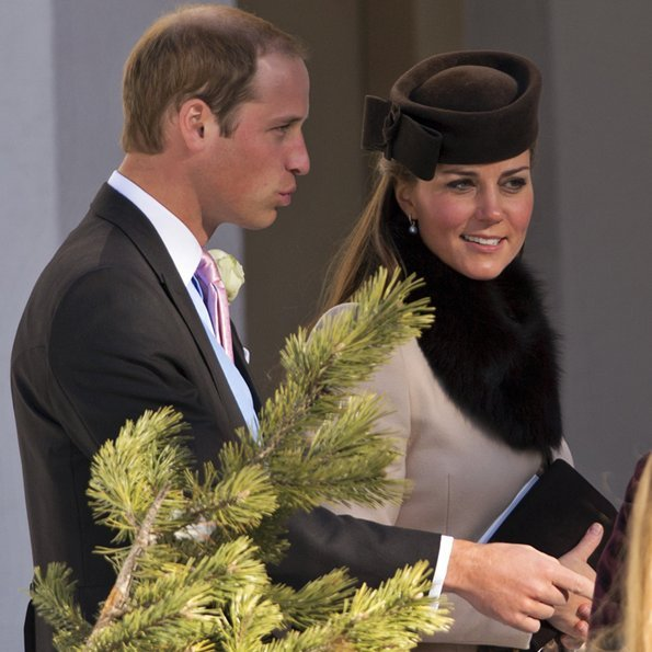 Kate wore a MaxMara dress and completed her look with a brown hat and drop-pearl earrings