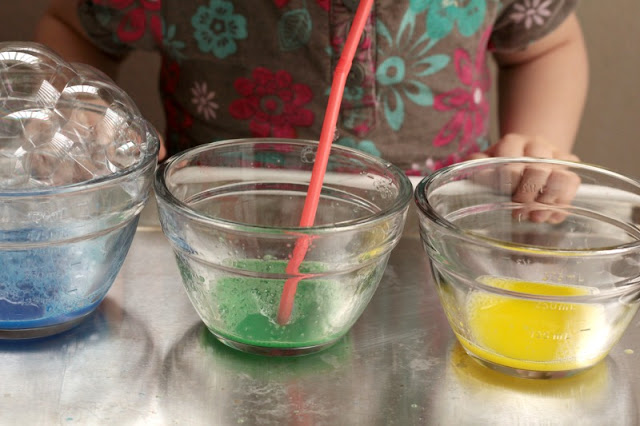 use a straw to blow in the paint, water, dish soap mixture to make bubbles