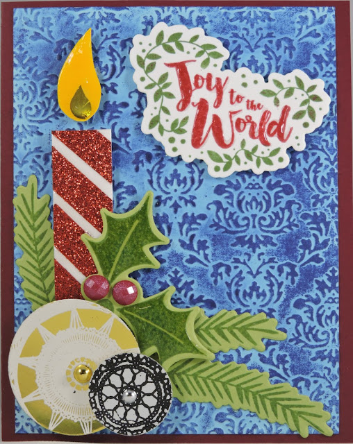 Christmas card with candle, ornament and Joy to the World sentiment.