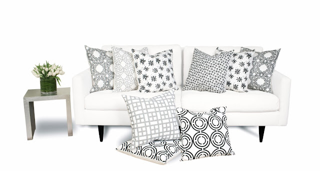 COCOCOZY Light pillows in black and white on sofa with silver side table home decor accessories textiles