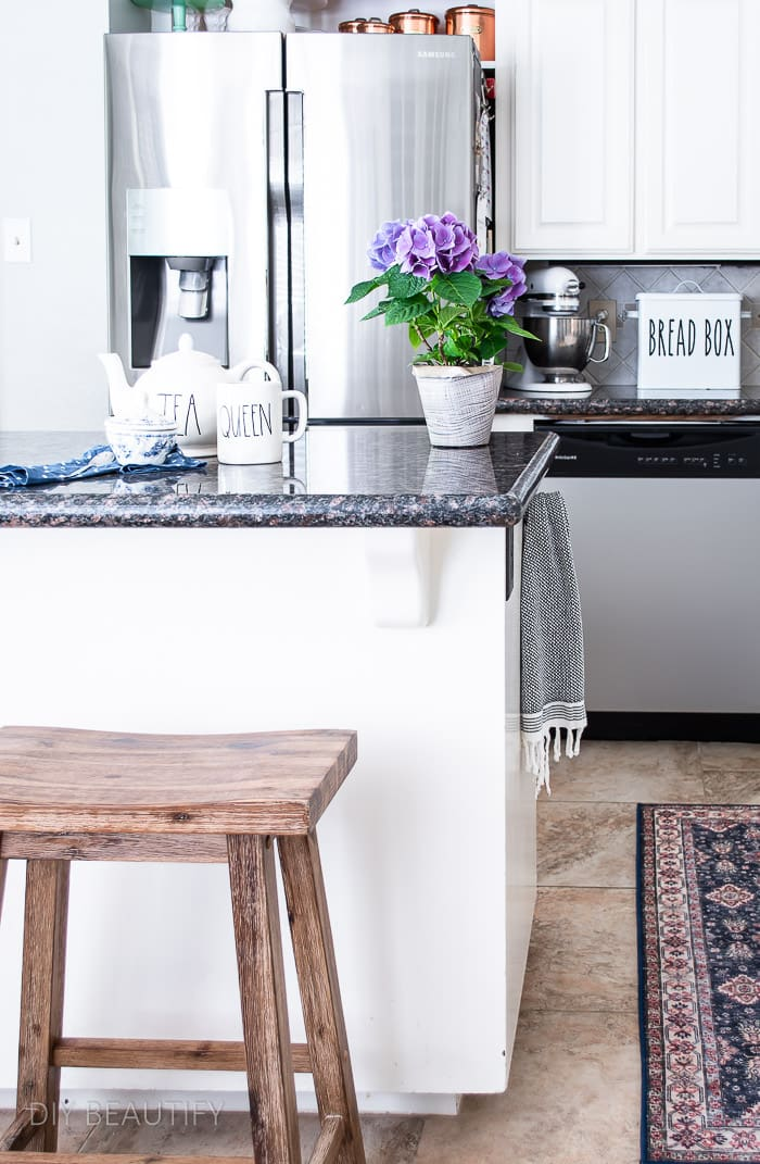 black and white kitchen island with wood stool