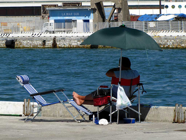 Angling in the shadow of a parasol, port of Livorno