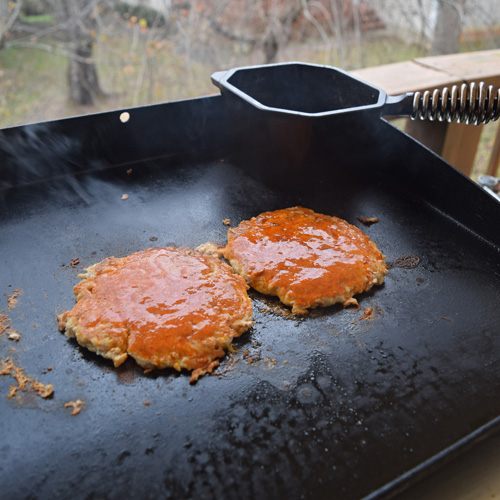 I sauce them right after flipping so the sauce has time to cook onto the burgers.