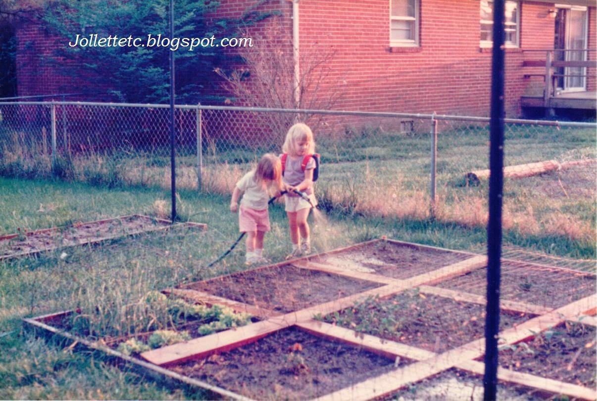 Zoe and Jordan Mathias watering the garden 1985