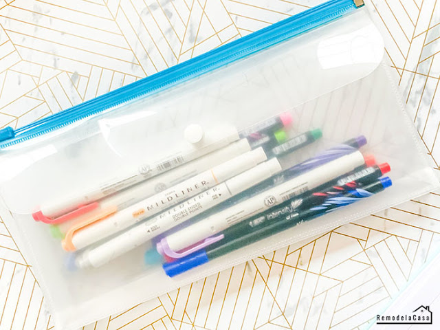 clear pencil pouch with pens and markers
